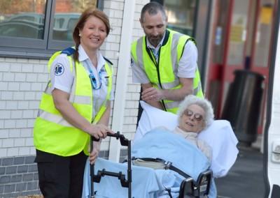 E-zec Medical staff transporting an elderly patient.