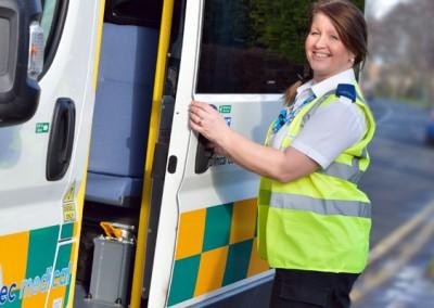 E-zec Medical employee with an E-zec ambulance.