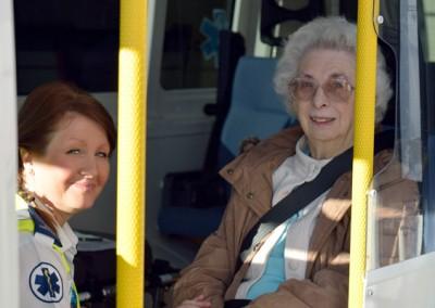 E-zec Medical employee transporting an elderly patient.